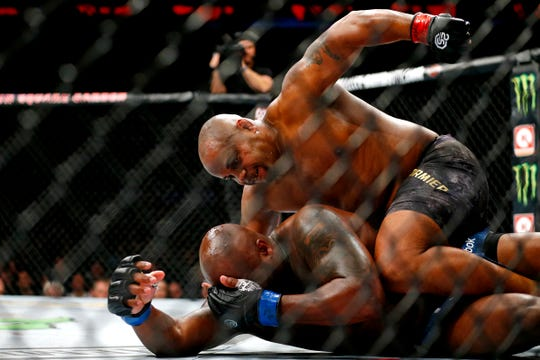 Nov 3, 2018; New York, NY, USA; Daniel Cormier (red gloves) fights Derrick Lewis (blue gloves) during UFC 230 at Madison Square Garden. Mandatory Credit: Noah K. Murray-USA TODAY Sports
