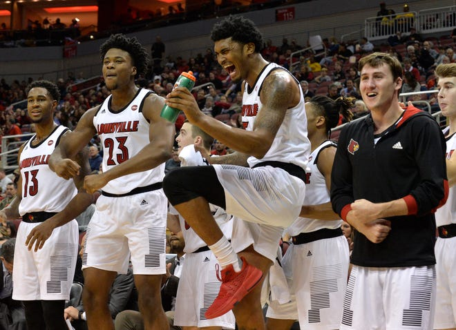 Louisville players cheer on their teammates during the second half of their game against Simmons College, Saturday, Nov. 03, 2018 in Louisville Ky. Louisville won 90-41.