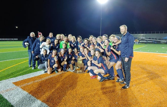 Sacred Heart soccer players celebrate their 2018 state title. Nov. 3, 2018
