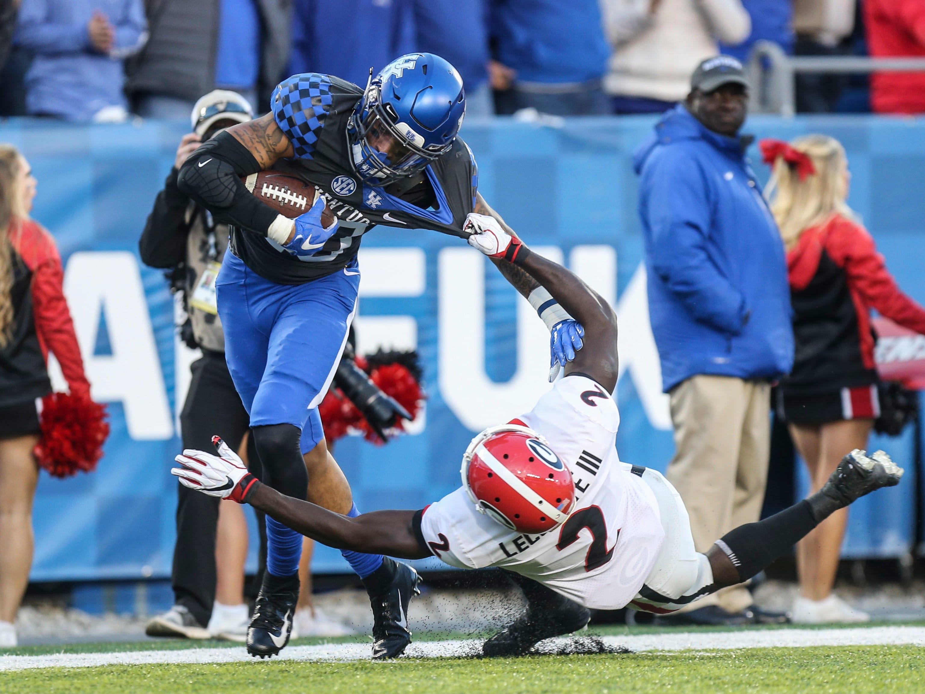 Kentucky's A.J. Rose couldn't be stopped by Georgia's Richard Lecounte as he scored a second half touchdown Saturday. However, the Bulldogs proved too much for the Wildcats. Nov. 3, 2018