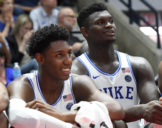 Aug 15, 2018; Toronto, Ontario, Canada; Duke University forwards Zion Williamson (1, right) and R.J. Barrett (5) talk on the bench after being substituted in a pre-season exhibition game against Ryerson University at Paramount Fine Foods Centre. Mandatory Credit: