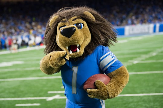 Detroit Lions mascot Roary is one of the Grand Marshals for the 22nd Annual Electric Light Parade held during Silver Bells in the City.