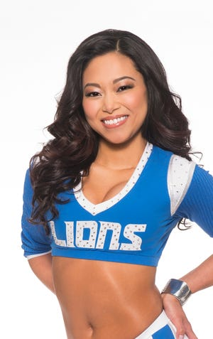 Detroit Lions Cheerleaders and Roary, the Detroit Lions mascot, are grand marshals in the 2018 Electric Light Parade  held during Silver Bells in the City in downtown Lansing. Pictured is Detroit Lions cheerleader Lindsey.