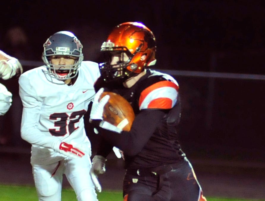 Lucas' Kaiden Thomas runs with the ball while playing against River while playing at Madison on Saturday night.