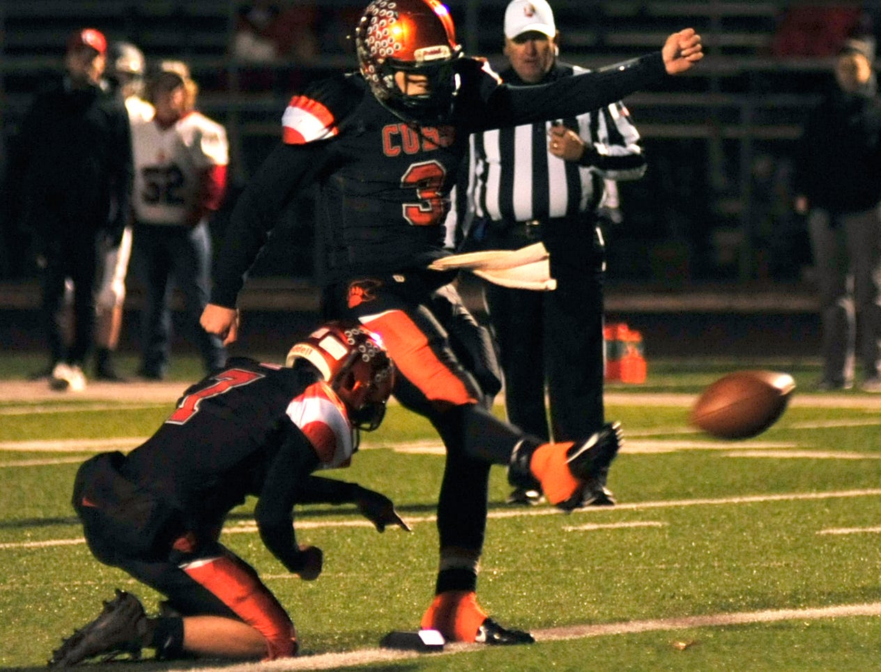 Lucas' Logan Niswander makes a kick while playing against River while playing at Madison on Saturday night.
