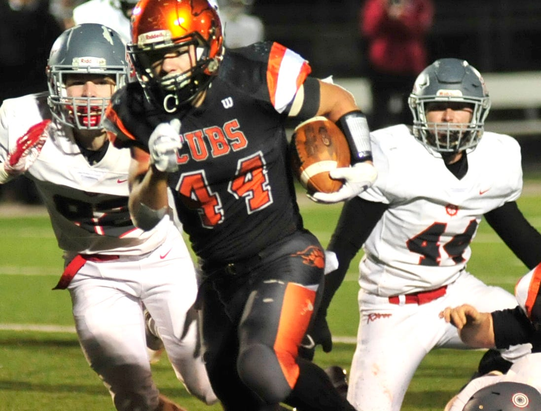 Lucas' Jeb Grover runs with the ball while playing against River while playing at Madison on Saturday night.