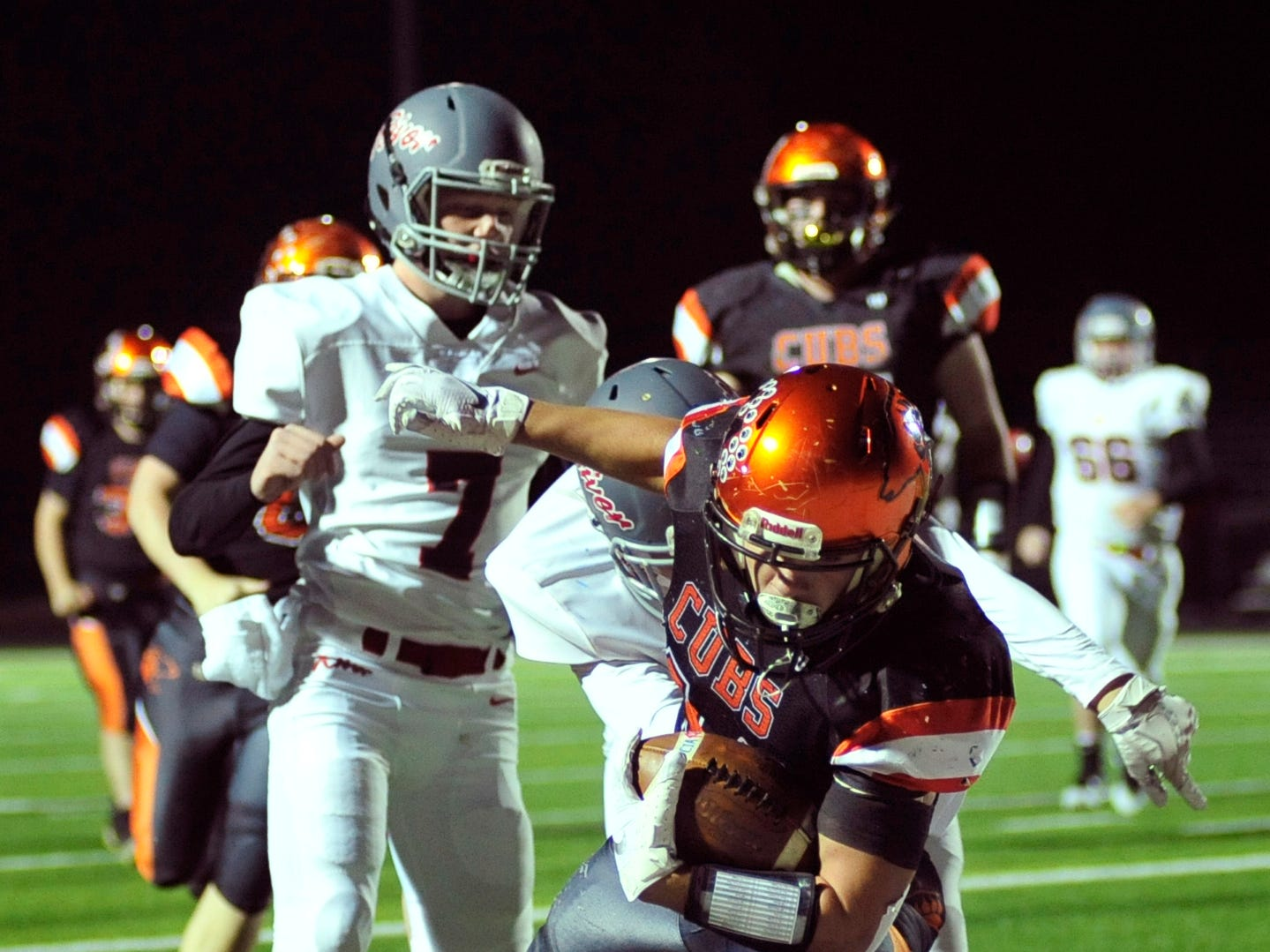 Lucas' Jeb Grover scores a touchdown while playing against River while playing at Madison on Saturday night.