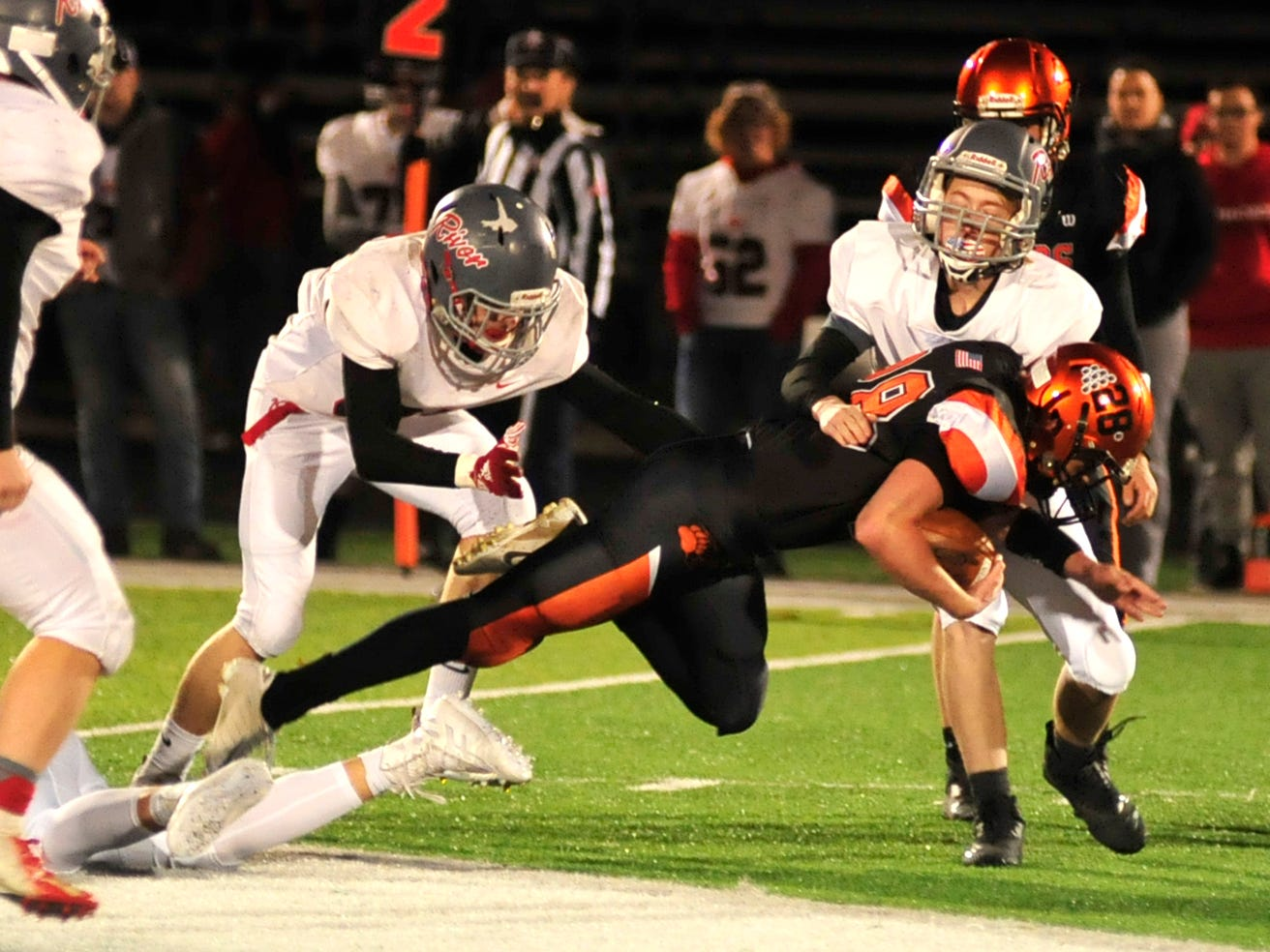 Lucas' Timmy Fife dives with the ball while playing against River while playing at Madison on Saturday night.