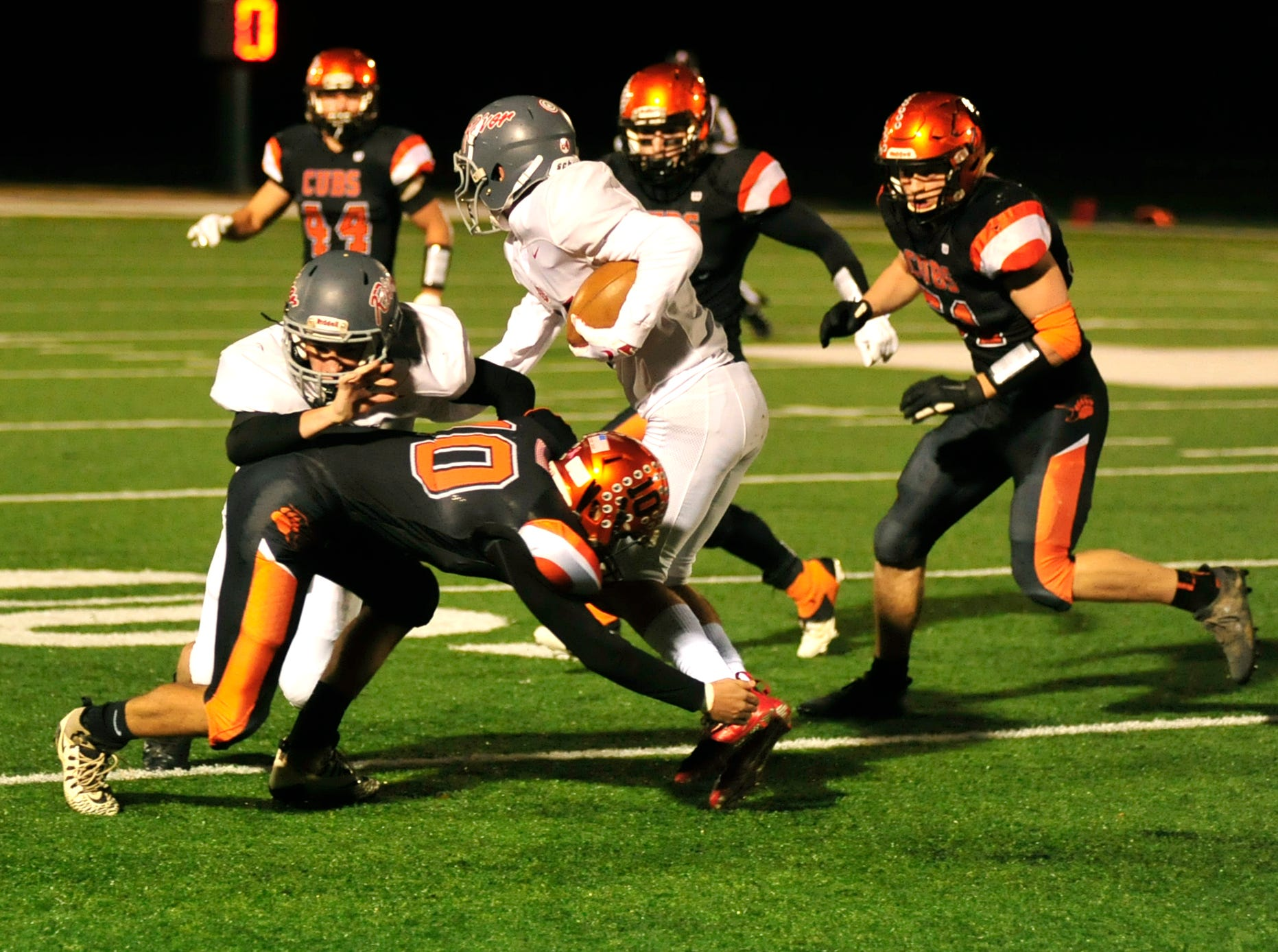 Lucas' Ethan Sauder tackles a player while playing against River while playing at Madison on Saturday night.