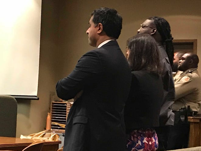 Tremaine Wilbourn stands with his legal team after being found guilty Sunday of first-degree murder in the killing of MPD officer Sean Bolton in 2015. The state has asked for the death penalty.