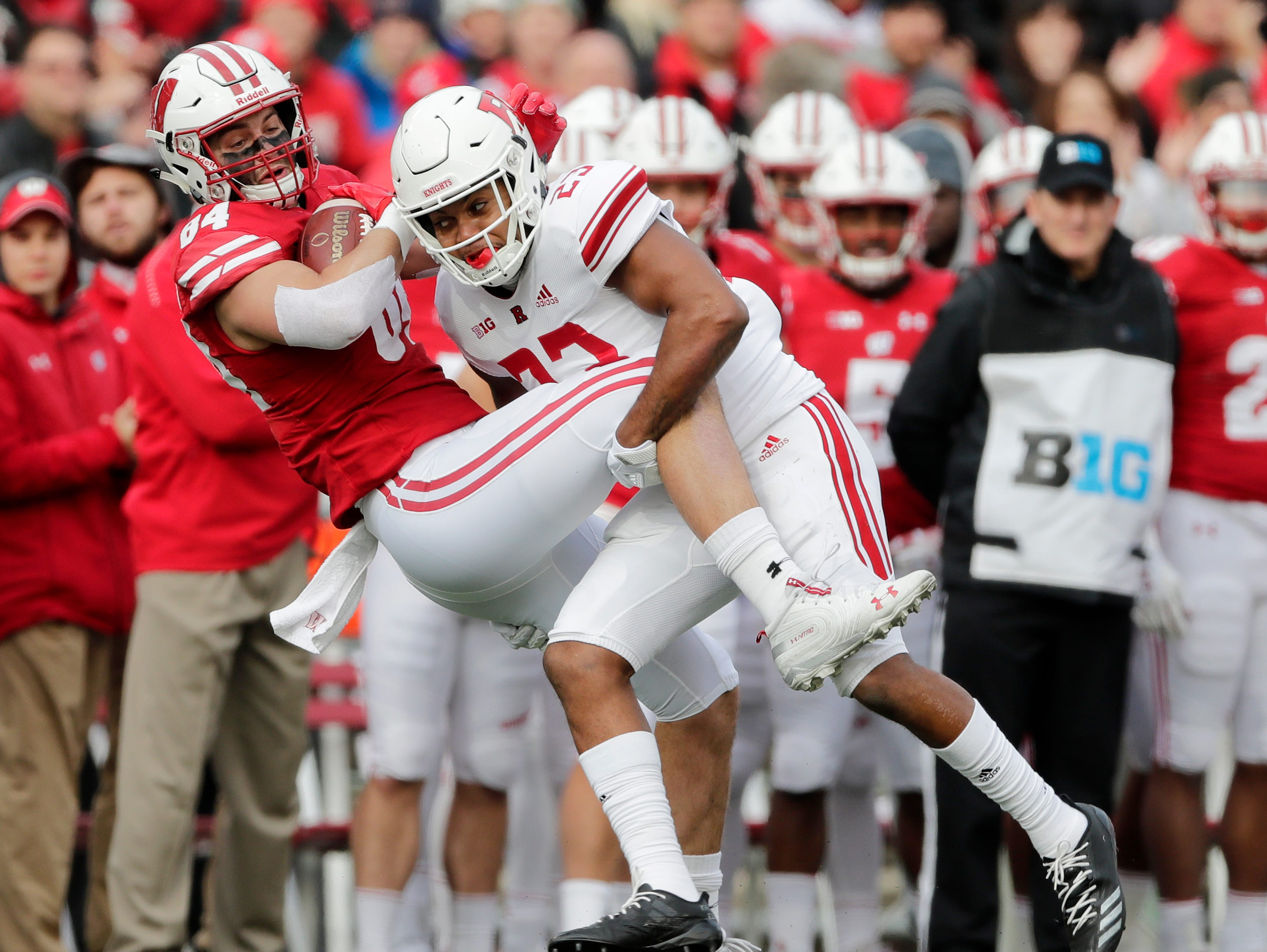 Rutgers Scarlet Knights defensive back Kiy Hester (23) tackles Wisconsin Badgers tight end Jake Ferguson (84) in the first quarter of a Big Ten football game at Camp Randall Stadium on Saturday, November 3, 2018 in Madison, Wis.Adam Wesley/USA TODAY NETWORK-Wisconsin