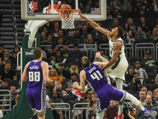 Giannis Antetokounmpo finishes a drive to the bucket by posterizing Kosta Koufos of the Kings with an emphatic dunk during the third quarter Sunday.