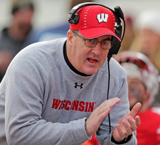 Wisconsin Badgers head coach Paul Chryst talks to his players on the bench during the second half of a Big Ten football game against the Rutgers Scarlet Knights at Camp Randall Stadium on Saturday, November 3, 2018 in Madison, Wis.