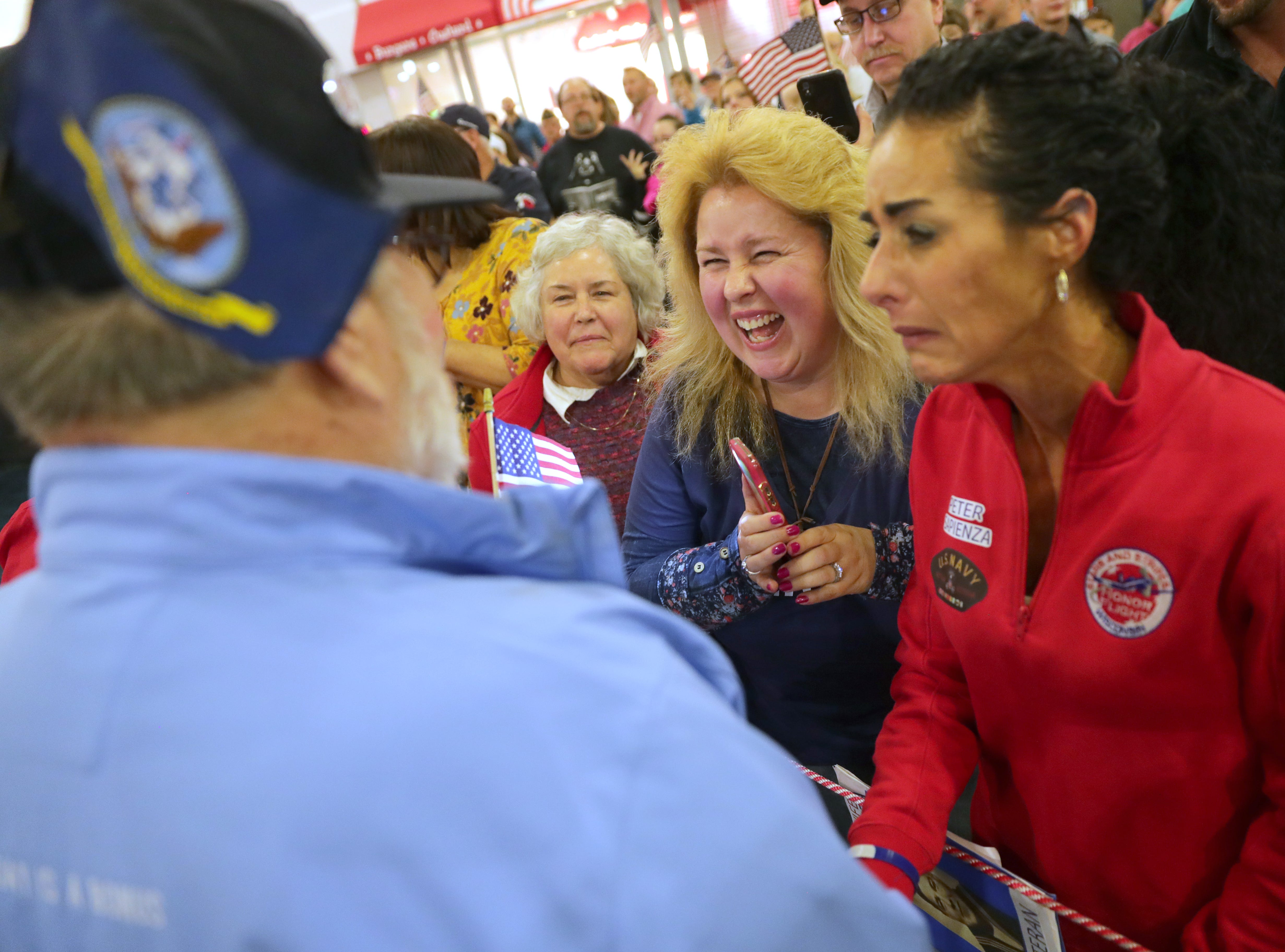 Vietnam Navy veteran Pete Sapienza of Big Bend is greeted by his wife, Laurie Sapienza (from left), and two daughters, Kathie Flitsch of Lannon and Amy Sapienza of Mukwonago during the Stars and Stripes Honor Flight welcome home ceremony.