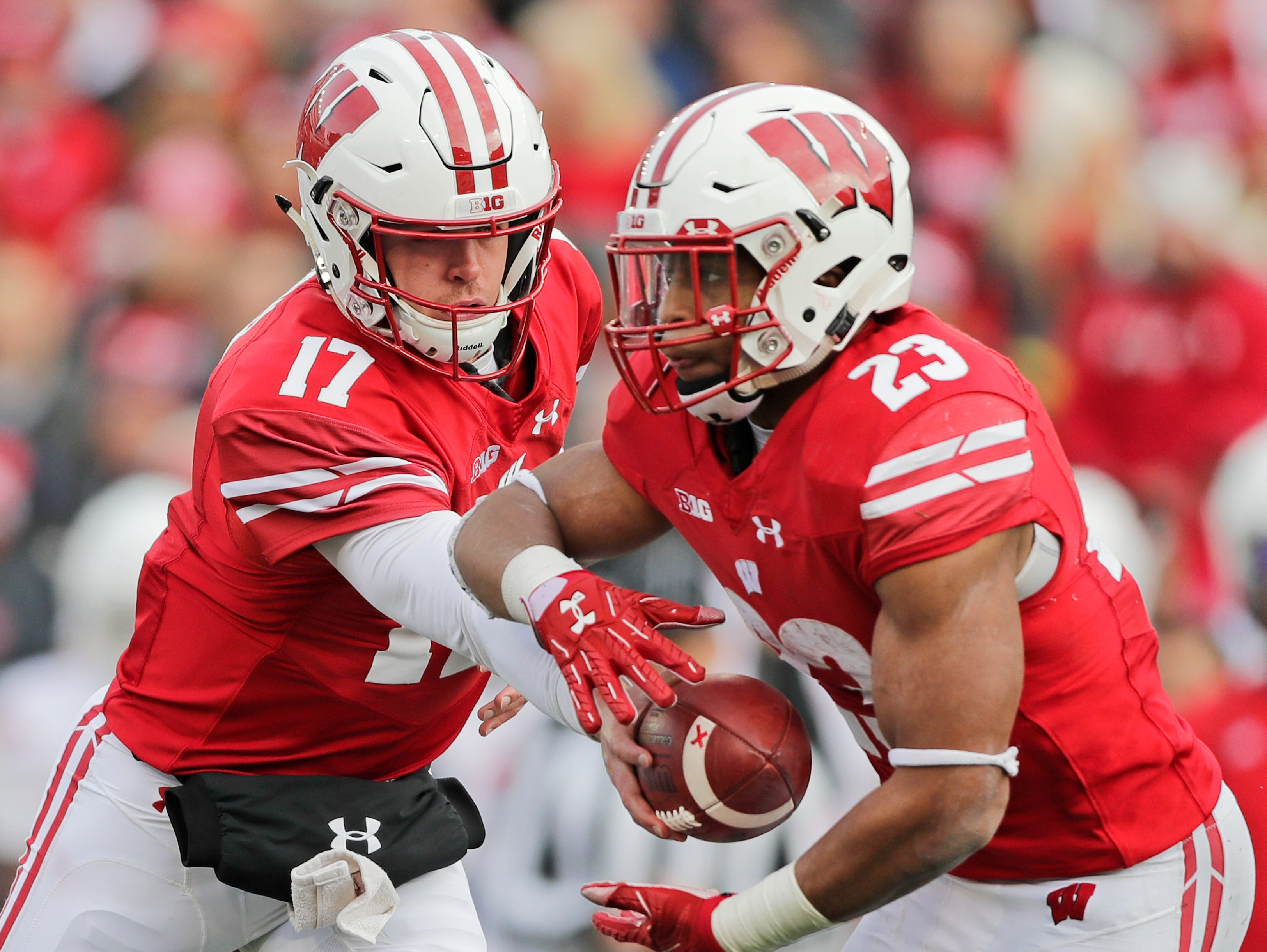Wisconsin Badgers quarterback Jack Coan (17) hands off the ball to Wisconsin Badgers running back Jonathan Taylor (23) in the third quarter against the Rutgers Scarlet Knights in a Big Ten football game at Camp Randall Stadium on Saturday, November 3, 2018 in Madison, Wis.Adam Wesley/USA TODAY NETWORK-Wisconsin