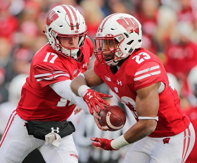 Quarterback Jack Coan and running back Jonathan Taylor hope to lead the Badgers to a 13th straight victory over Purdue Saturday afternoon.