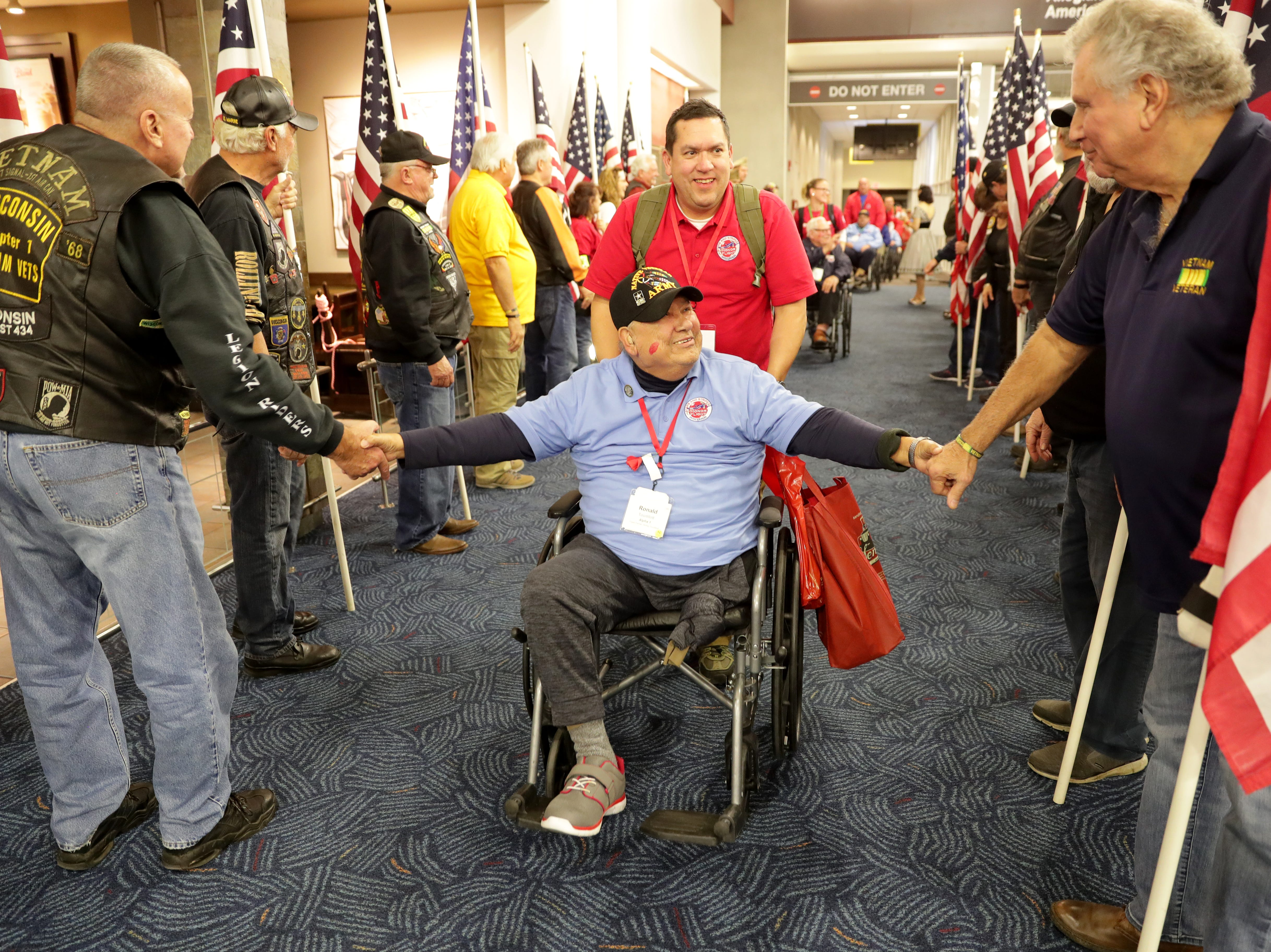 Vietnam veteran Ronald Tourtillott is greeted with his guardian, Ricky Tourtillott, during the welcome home ceremony.