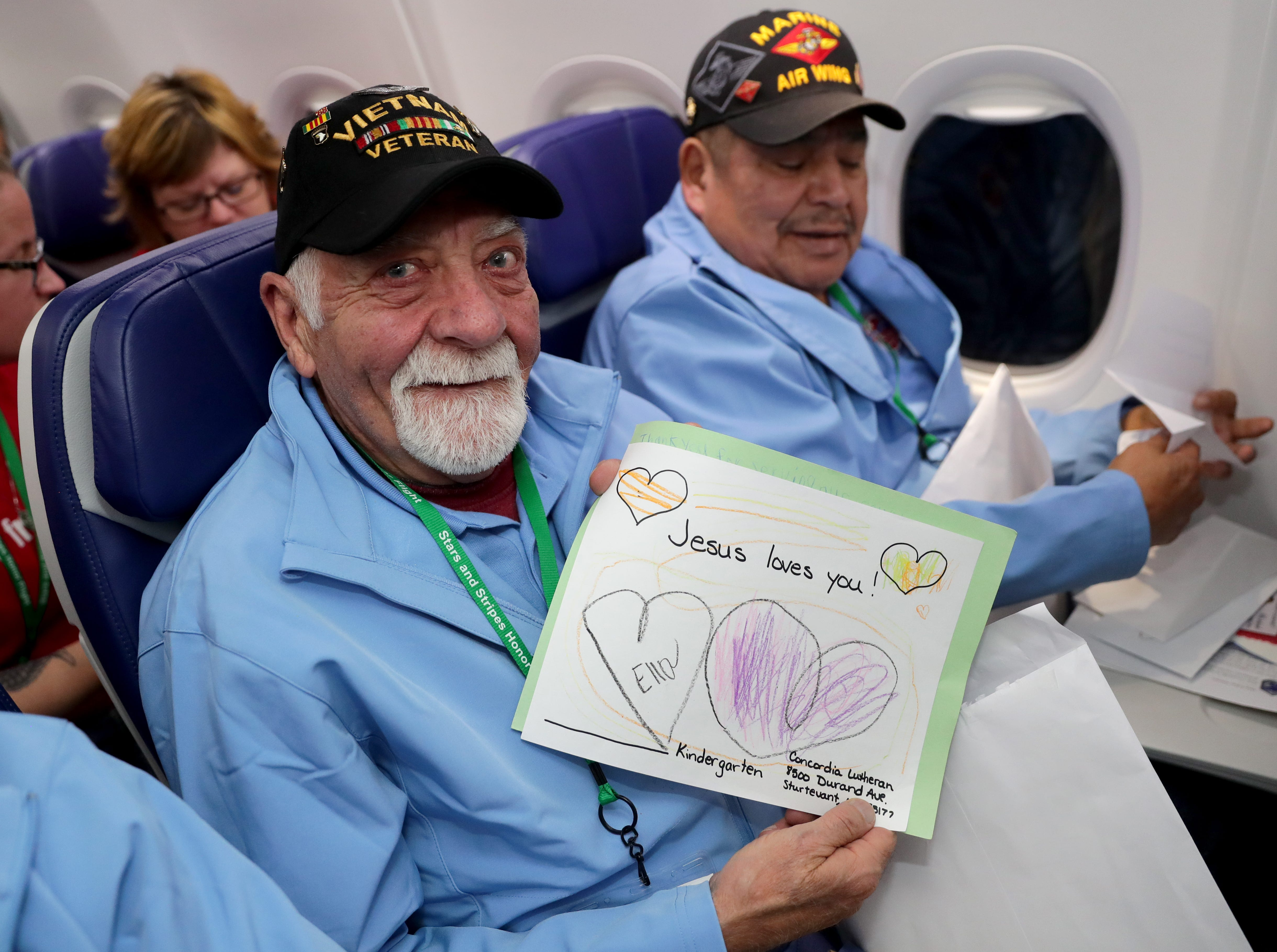 Bill Grant, a Vietnam Army veteran, holds a letter from a family member during mail call.