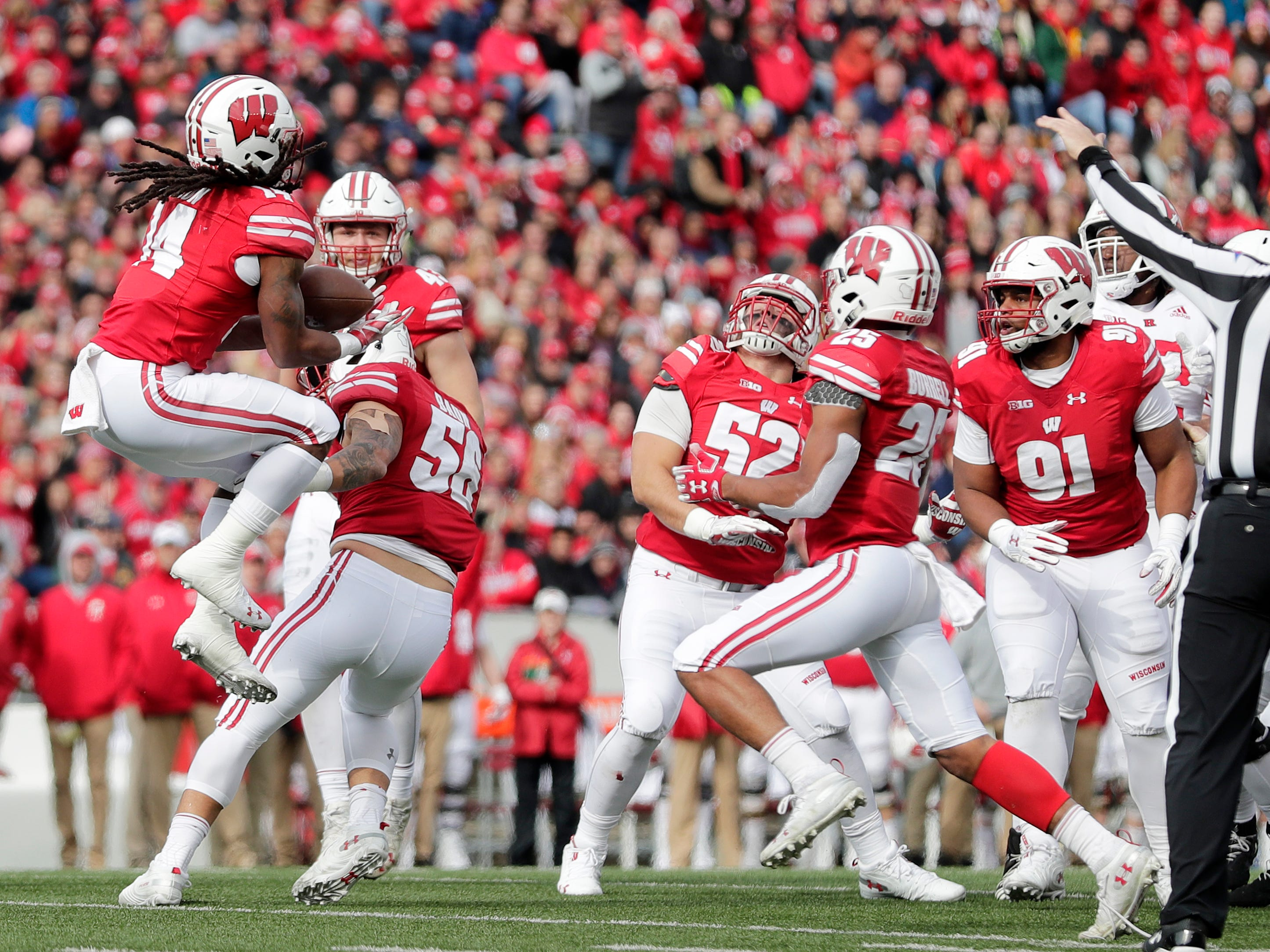 Wisconsin Badgers safety D'Cota Dixon (14) recovers a blocked punt against the Rutgers Scarlet Knights in the second quarterof a Big Ten football game at Camp Randall Stadium on Saturday, November 3, 2018 in Madison, Wis.Adam Wesley/USA TODAY NETWORK-Wisconsin