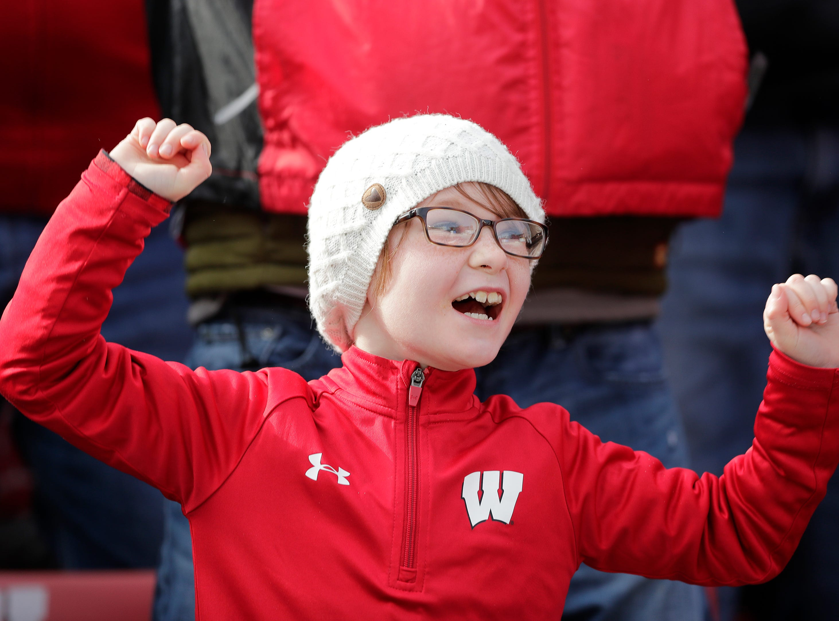 A young Wisconsin fan participates in 'Jump Around' at the end of the third quarter against the Rutgers Scarlet Knights in a Big Ten football game at Camp Randall Stadium on Saturday, November 3, 2018 in Madison, Wis.Adam Wesley/USA TODAY NETWORK-Wisconsin