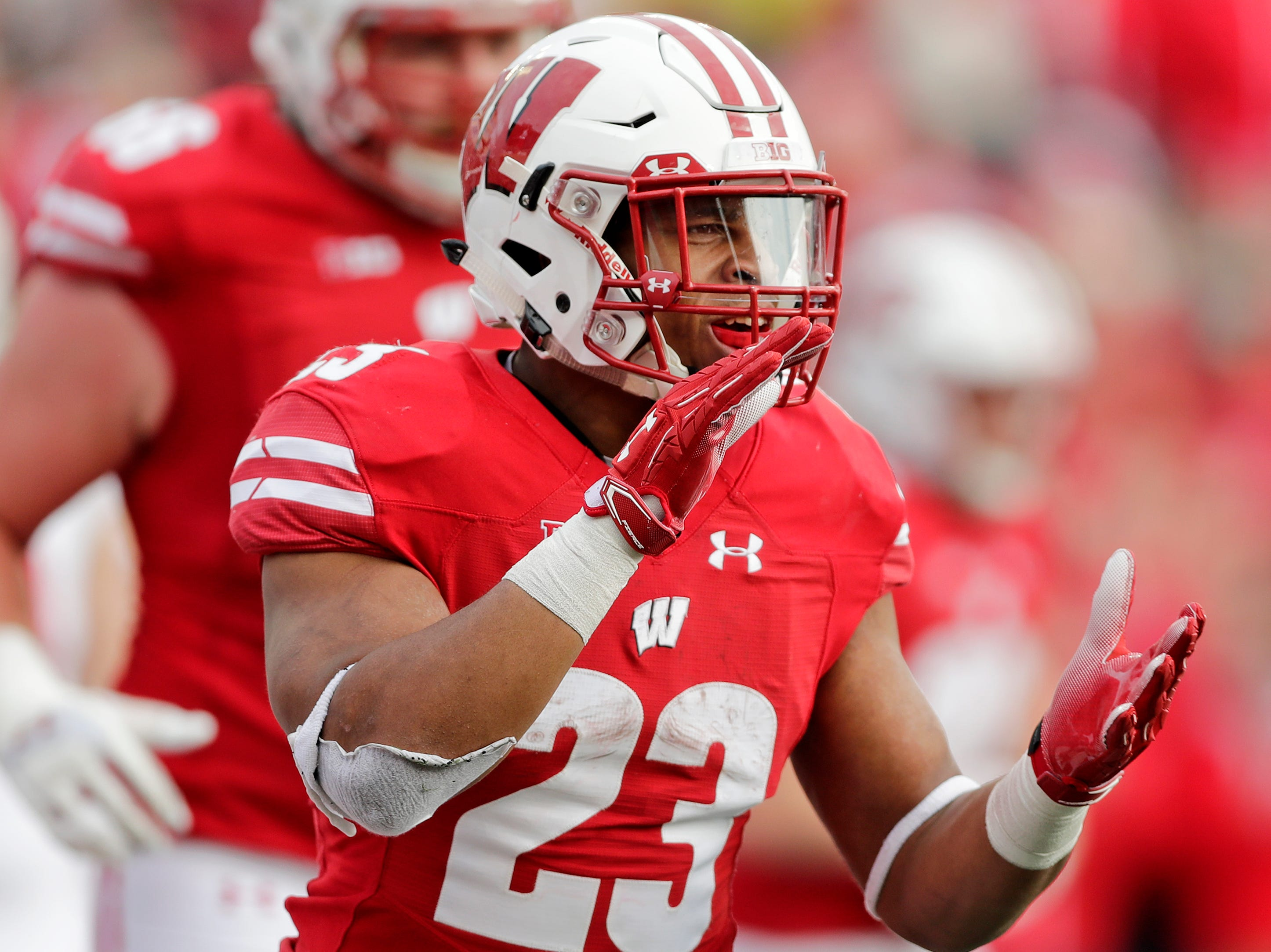 Wisconsin Badgers running back Jonathan Taylor (23) celebrates after scoring a touchdown against the Rutgers Scarlet Knights in the third quarter of a Big Ten football game at Camp Randall Stadium on Saturday, November 3, 2018 in Madison, Wis.Adam Wesley/USA TODAY NETWORK-Wisconsin