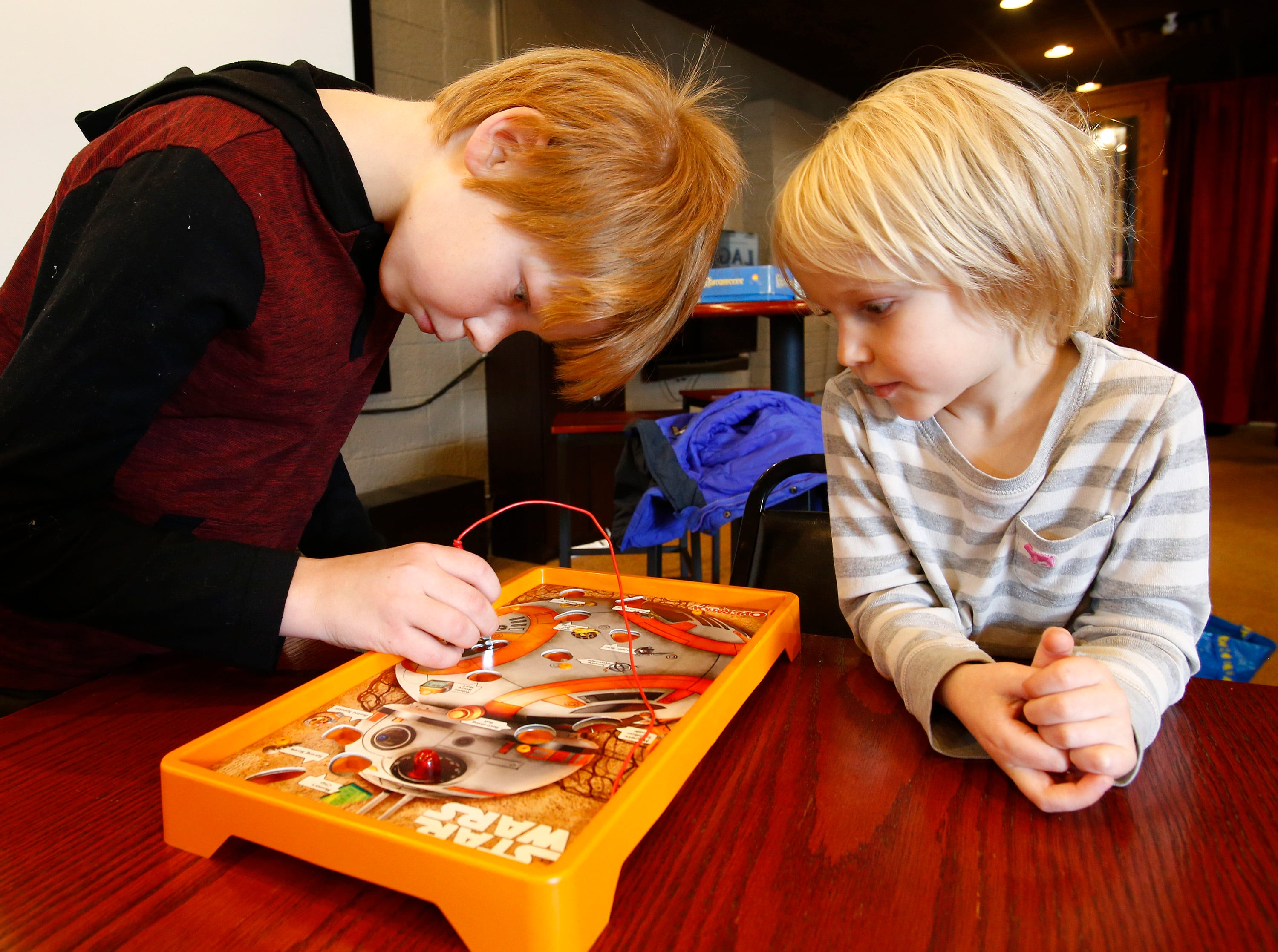 Clay (left) and Owen Skrzypchak of Kewaskum play a Star Wars version of Operation during a 12-hour Game-A-Thon hosted by FORGE, Feminist Organization for Rebel Geek Empowerment, to benefit Children's Hospital of Wisconsin at 42 Ale House in St. Francis on Nov. 3.