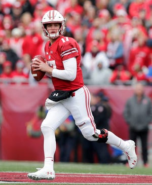 Badgers quarterback Jack Coan played the second half against Rutgers after starter Alex Hornibrook suffered another head injury.