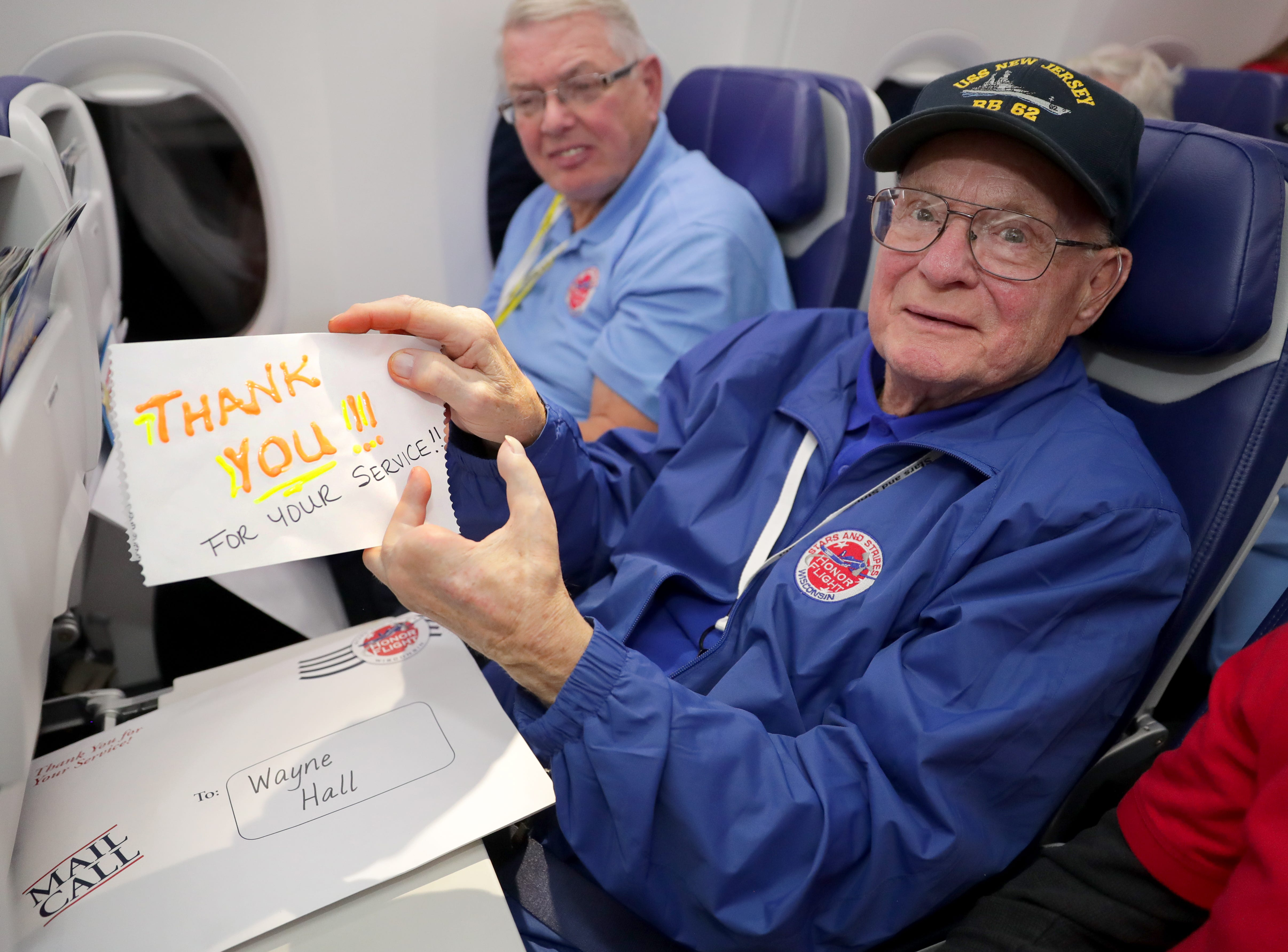 Korean Navy veteran Wayne Hall holds a thank-you note from a family member during mail call, where veterans are surprised by dozens of letters from loved ones.