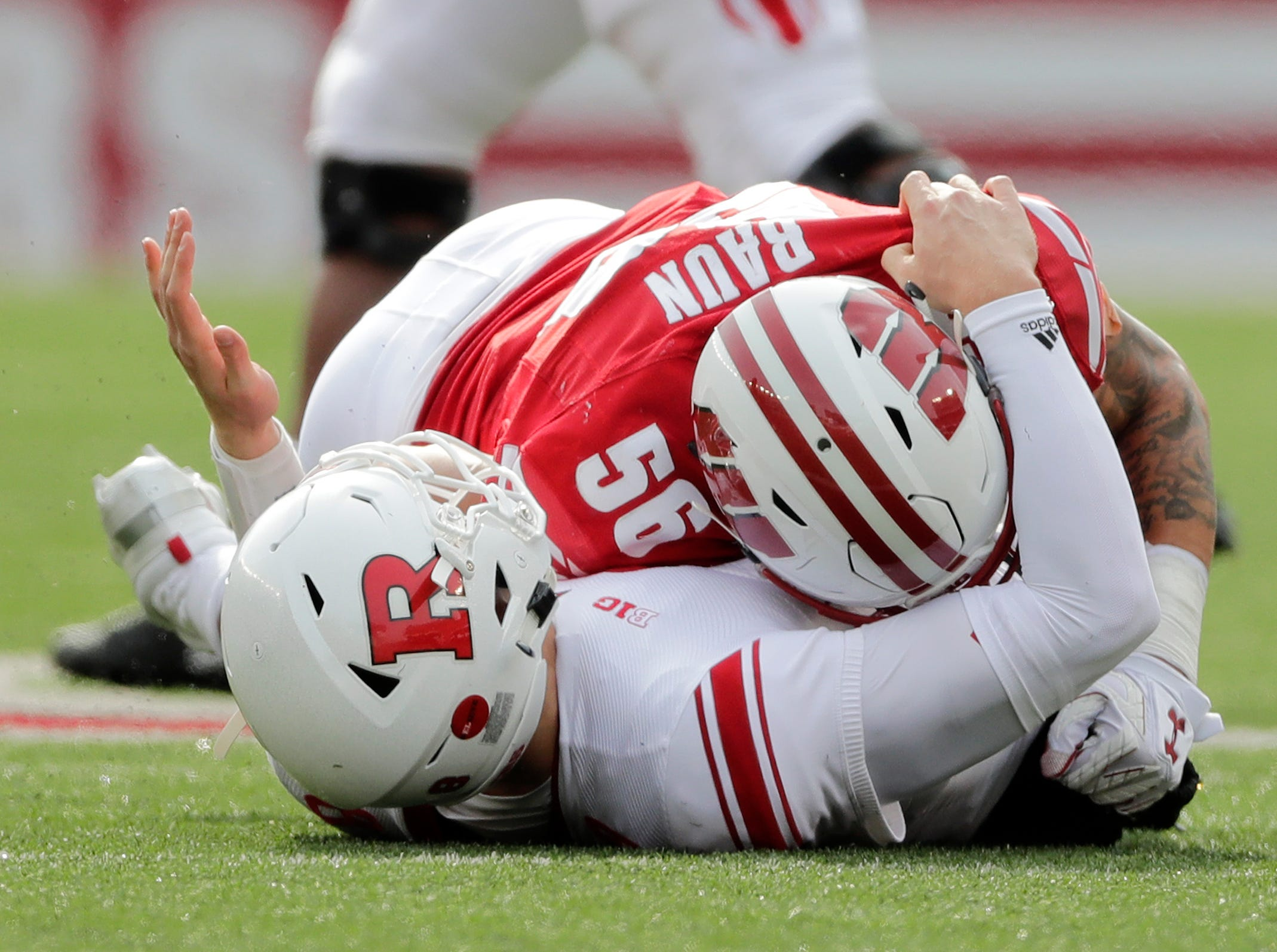 Wisconsin Badgers linebacker Zack Baun (56) hits Rutgers Scarlet Knights quarterback Artur Sitkowski (8) in the second quarter of a Big Ten football game at Camp Randall Stadium on Saturday, November 3, 2018 in Madison, Wis.Adam Wesley/USA TODAY NETWORK-Wisconsin