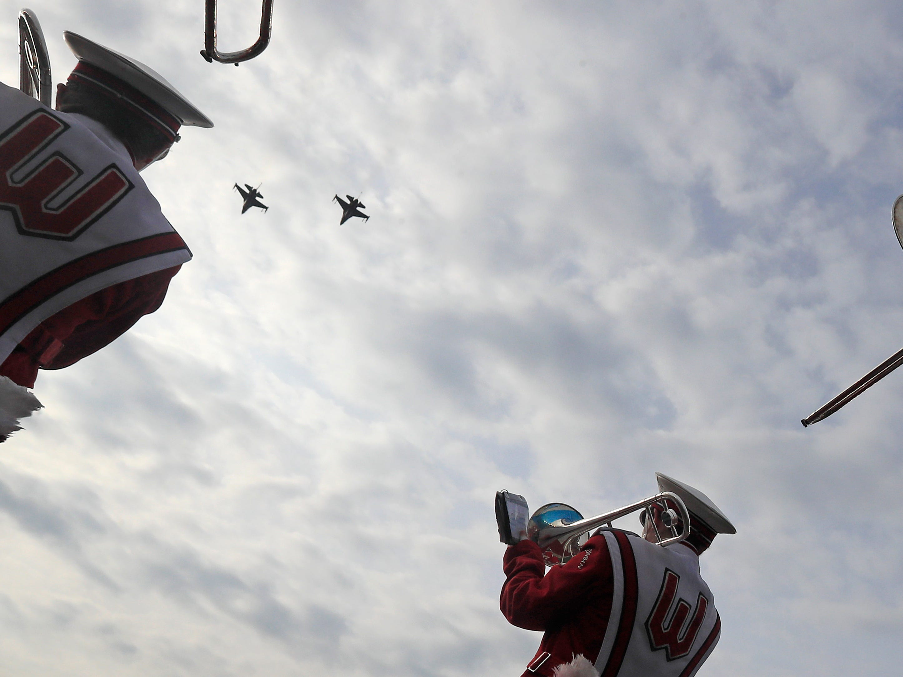 F-15 jets fly over after the national anthem before a Big Ten football game at Camp Randall Stadium on Saturday, November 3, 2018 in Madison, Wis.Adam Wesley/USA TODAY NETWORK-Wisconsin