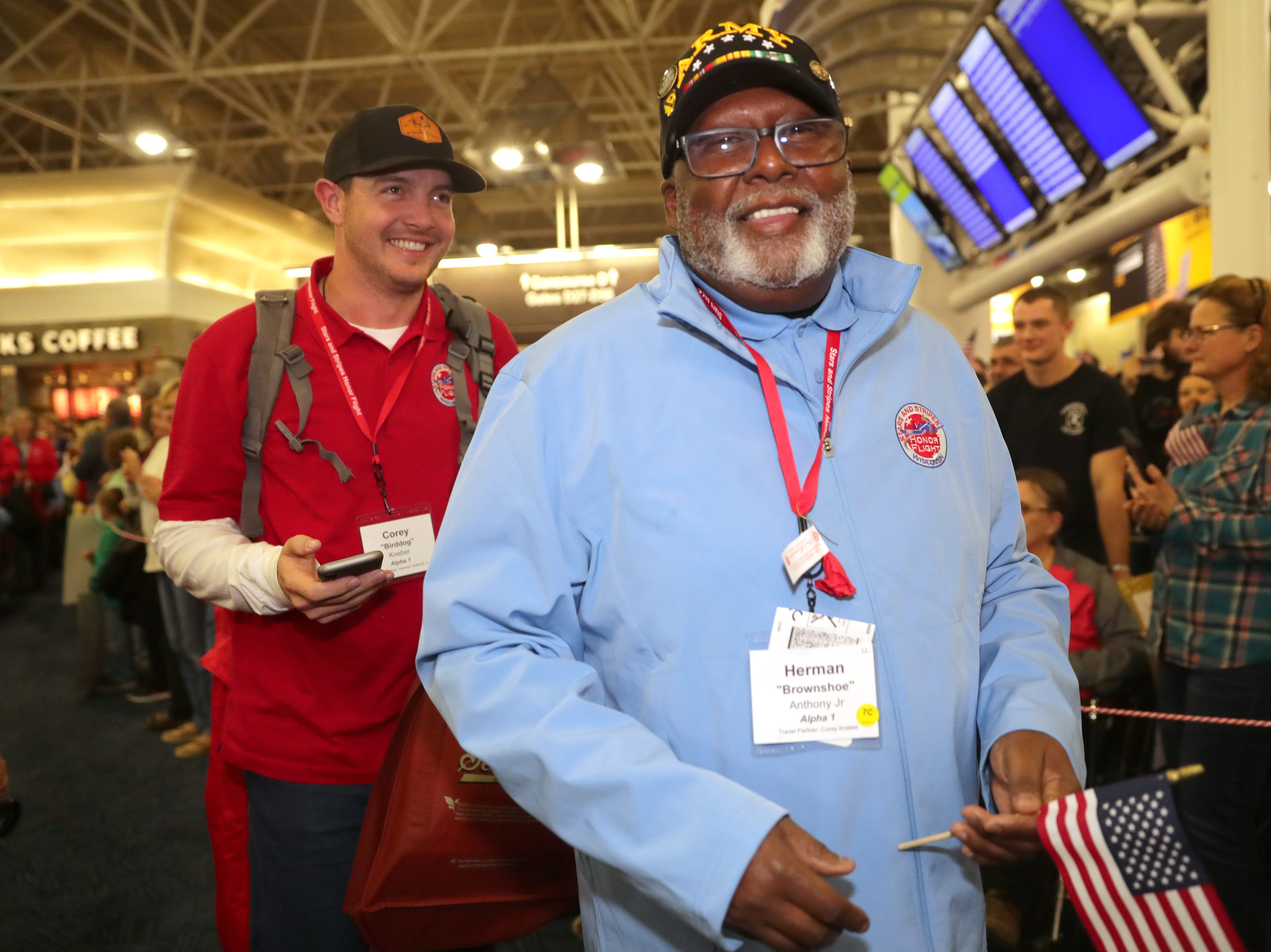 Vietnam Army veteran Herman Anthony Jr. of Brown Deer  is followed by his guardian, Milwaukee Brewers relief pitcher Corey Knebel,during the welcome home ceremony.