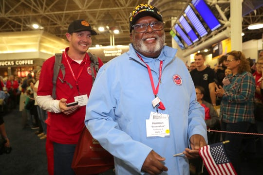 Vietnam Army veteran Herman Anthony Jr. of Brown Deer  is followed by his guardian, Milwaukee Brewers relief pitcher Corey Knebel, during the welcome home ceremony.