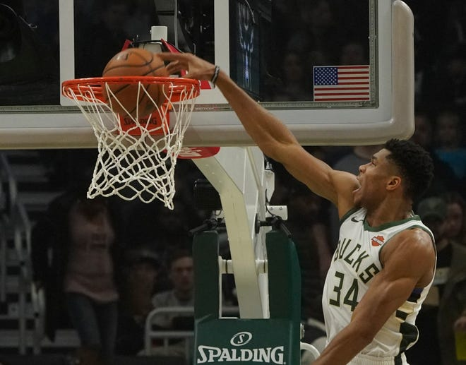 Giannis Antetokounmpo throws home a dunk against the Kings on Sunday. The Greek Freak registered a triple-double in the game with 26 points, 15 rebounds and 11 assists.