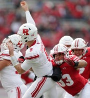 Wisconsin Badgers linebacker T.J. Edwards (53) pressues Rutgers Scarlet Knights quarterback Artur Sitkowski (8) in the second quarter of a Big Ten football game at Camp Randall Stadium on Saturday, November 3, 2018 in Madison, Wis.