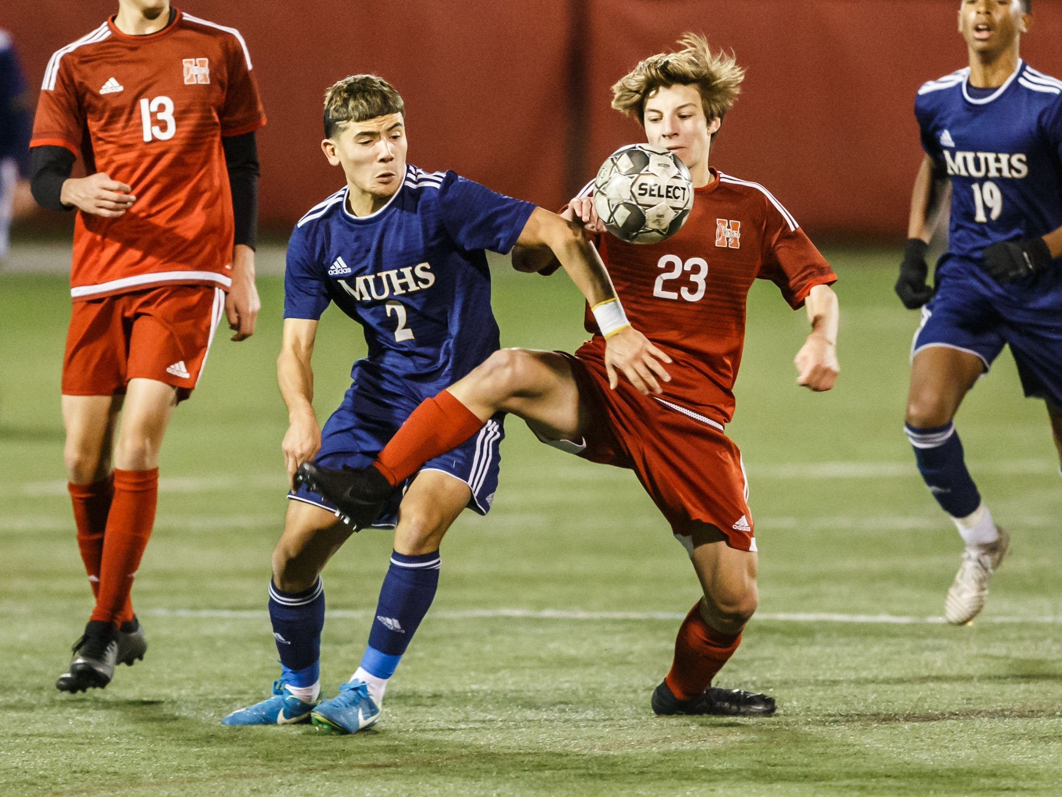 Sussex Hamilton sophomore Steven Arthur (23) battles for possession with Marquette's Miguel Herrera (2) during the WIAA Division 1 state soccer championship match Saturday.