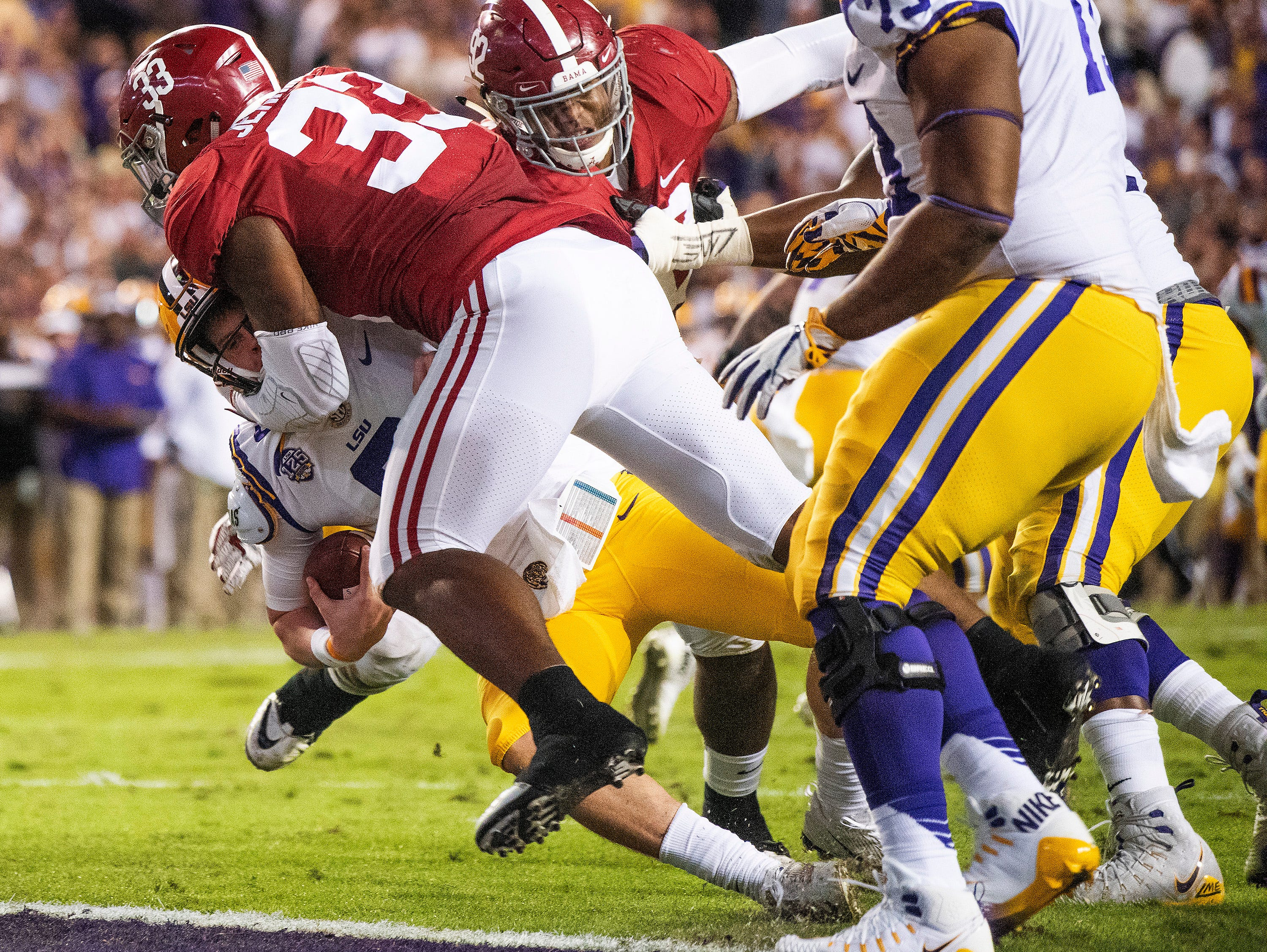 Alabama linebacker Anfernee Jennings (33) sacks Louisiana State University quarterback Joe Burrow (9) near the goal line in first half action at Tiger Stadium in Baton Rouge, La., on Saturday November 3, 2018.
