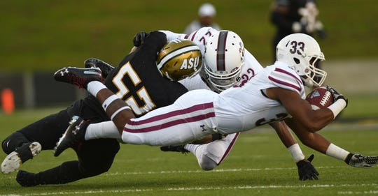 Texas Southern running back Rajan Cunningham (33) stretches for yardage during the second half Saturday, Nov. 3, 2018, at Alabama State University in Montgomery, Ala.