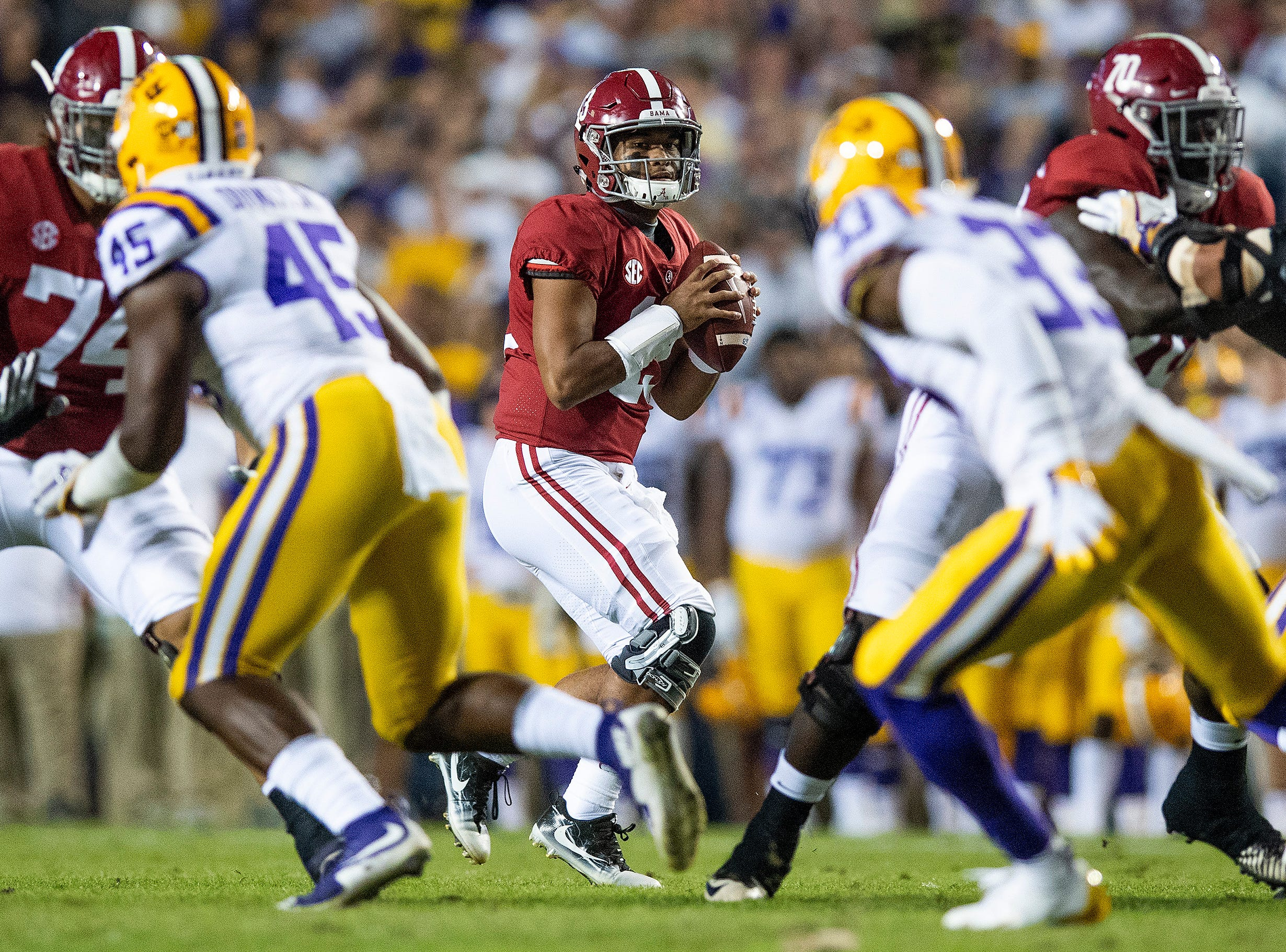 Alabama quarterback Tua Tagovailoa (13) looks to pass against Louisiana State University in first half action at Tiger Stadium in Baton Rouge, La., on Saturday November 3, 2018.