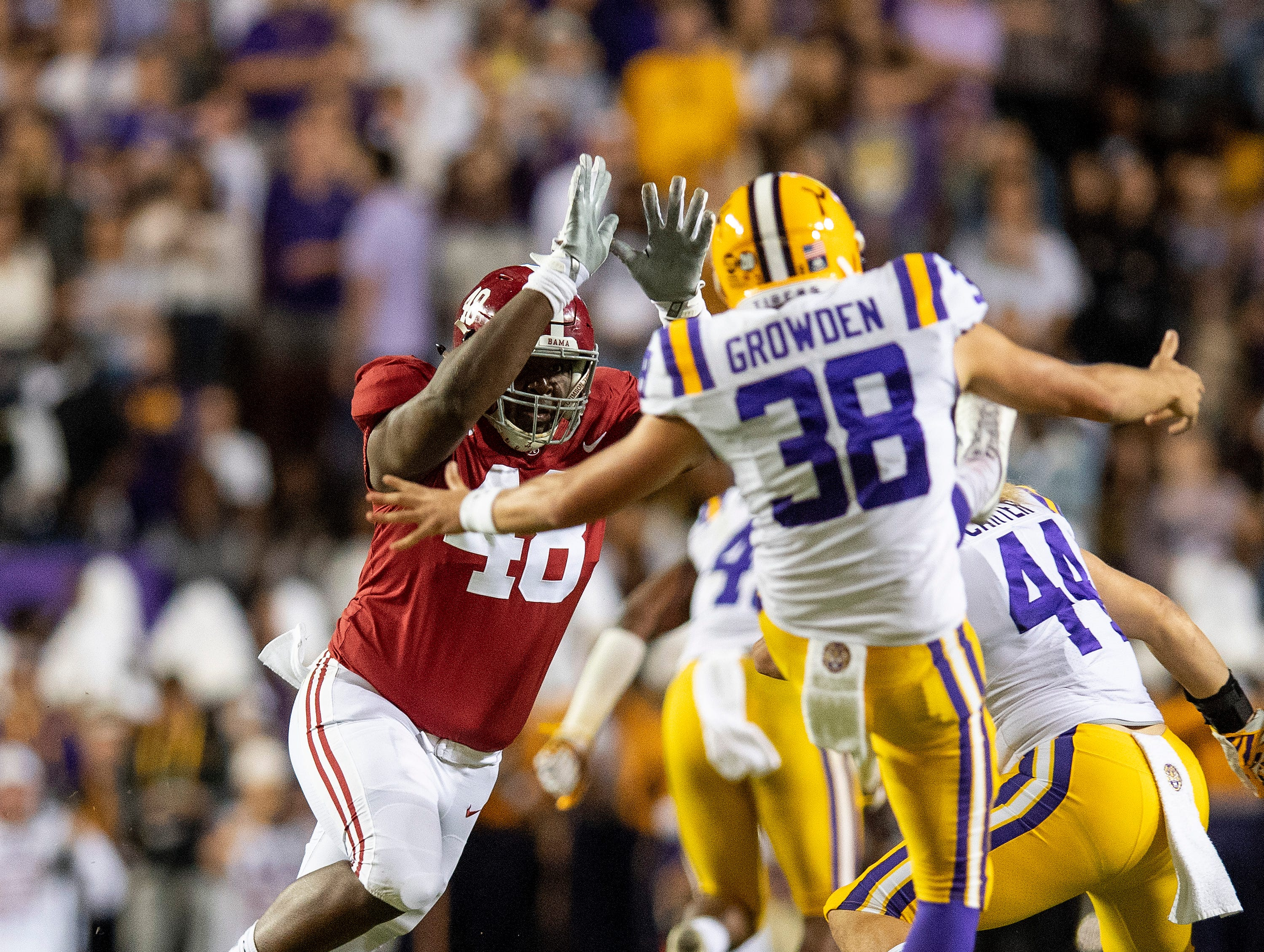 Alabama defensive lineman Phidarian Mathis (48) pressures Louisiana State University punter Josh Growden (38) in first half action at Tiger Stadium in Baton Rouge, La., on Saturday November 3, 2018.