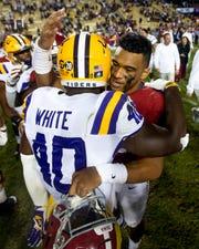 Alabama quarterback Tua Tagovailoa (13) hugs Louisiana State University linebacker Devin White (40) after defeating LSU at Tiger Stadium in Baton Rouge, La., on Saturday November 3, 2018.