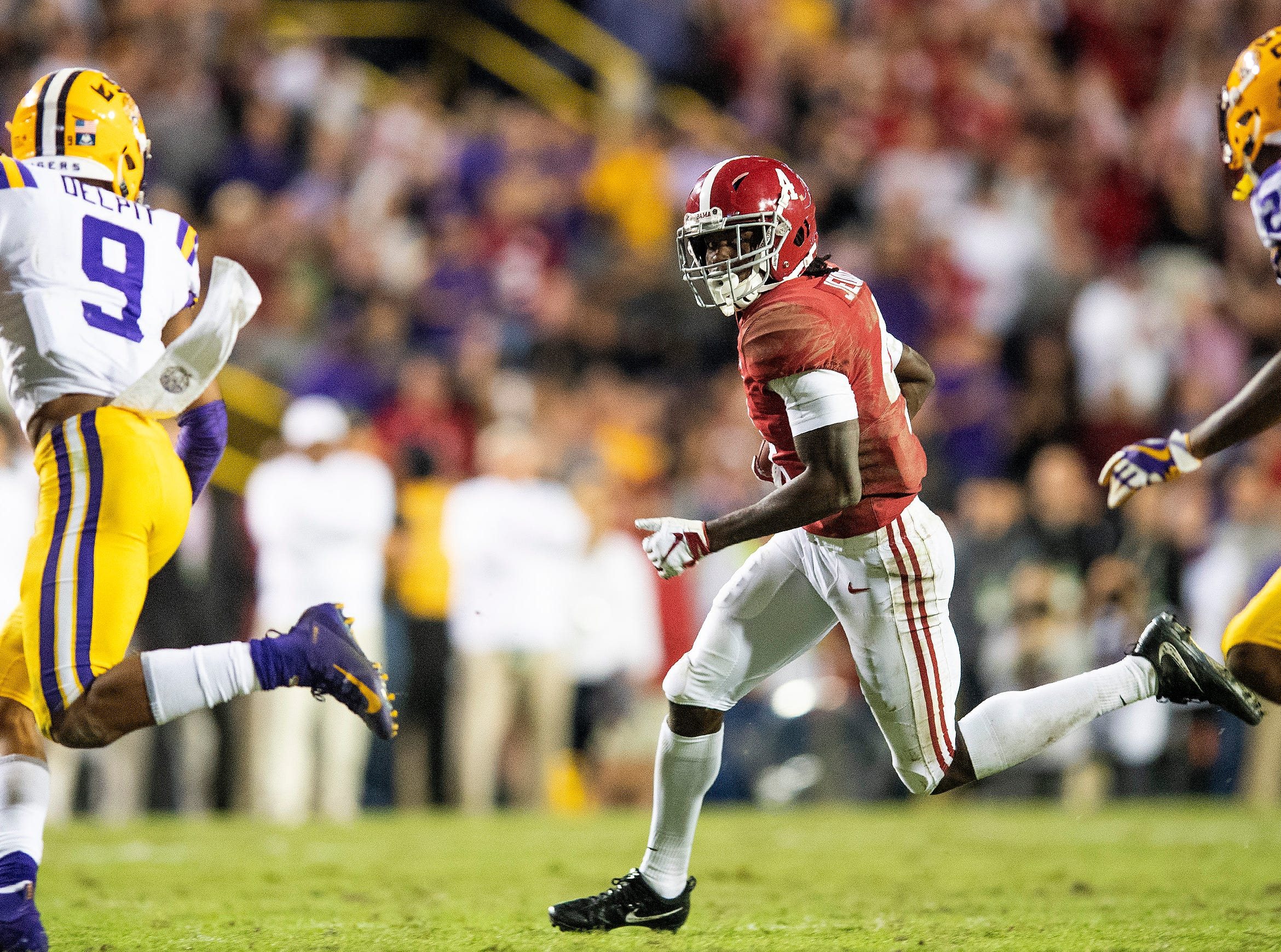 Alabama wide receiver Jerry Jeudy (4) carries the ball against LSU in second half action at Tiger Stadium in Baton Rouge, La., on Saturday November 3, 2018.