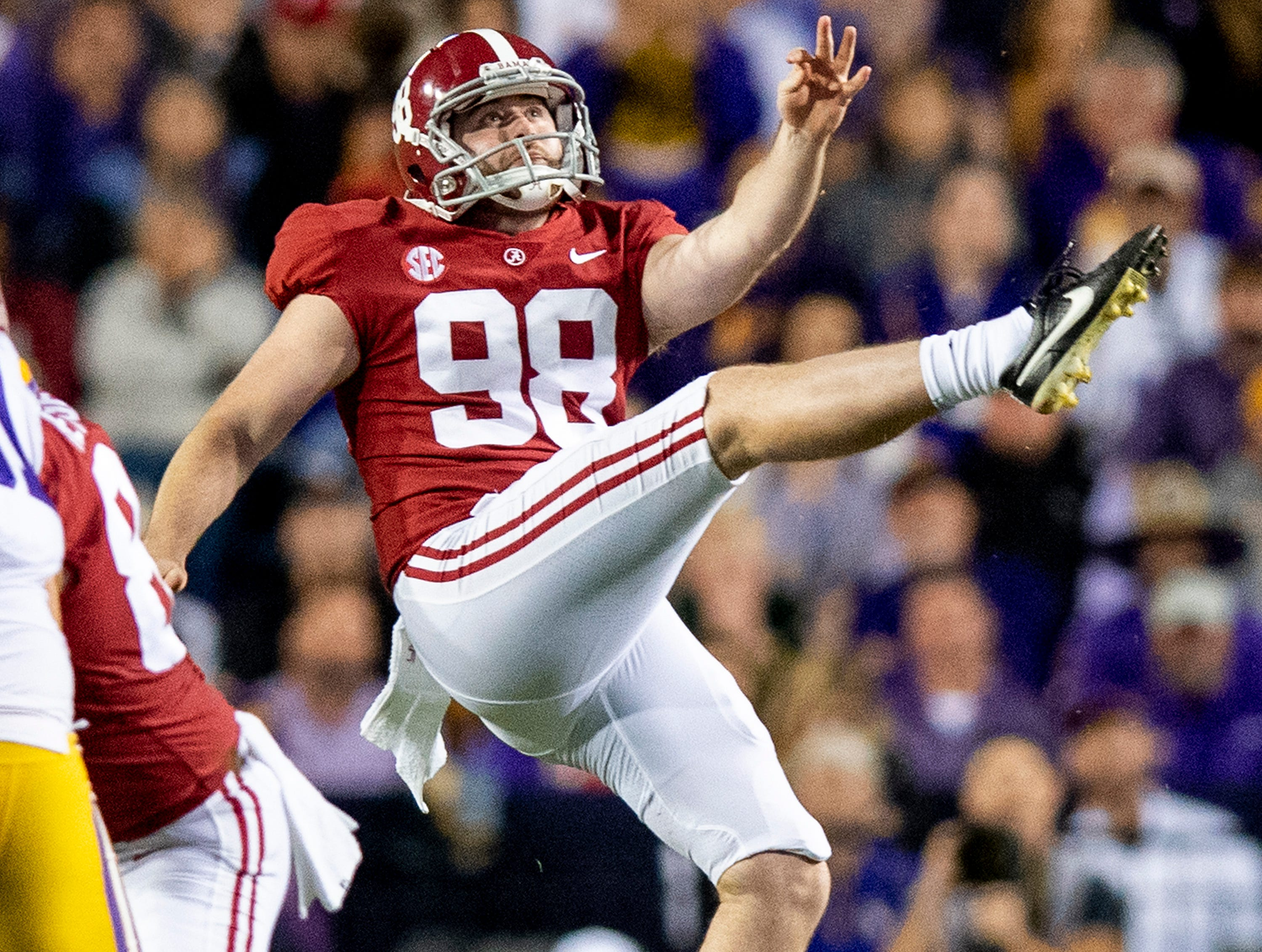 Alabama punter Mike Bernier (98) punts against LSU in second half action at Tiger Stadium in Baton Rouge, La., on Saturday November 3, 2018.