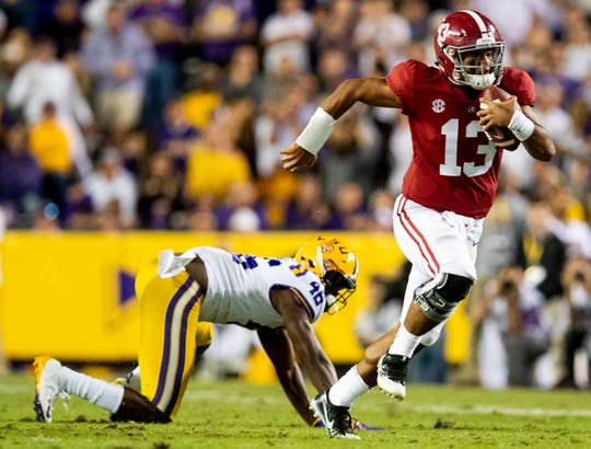 Alabama quarterback Tua Tagovailoa (13) breaks free for a touchdown run against LSU in second half action at Tiger Stadium in Baton Rouge, La., on Saturday November 3, 2018.