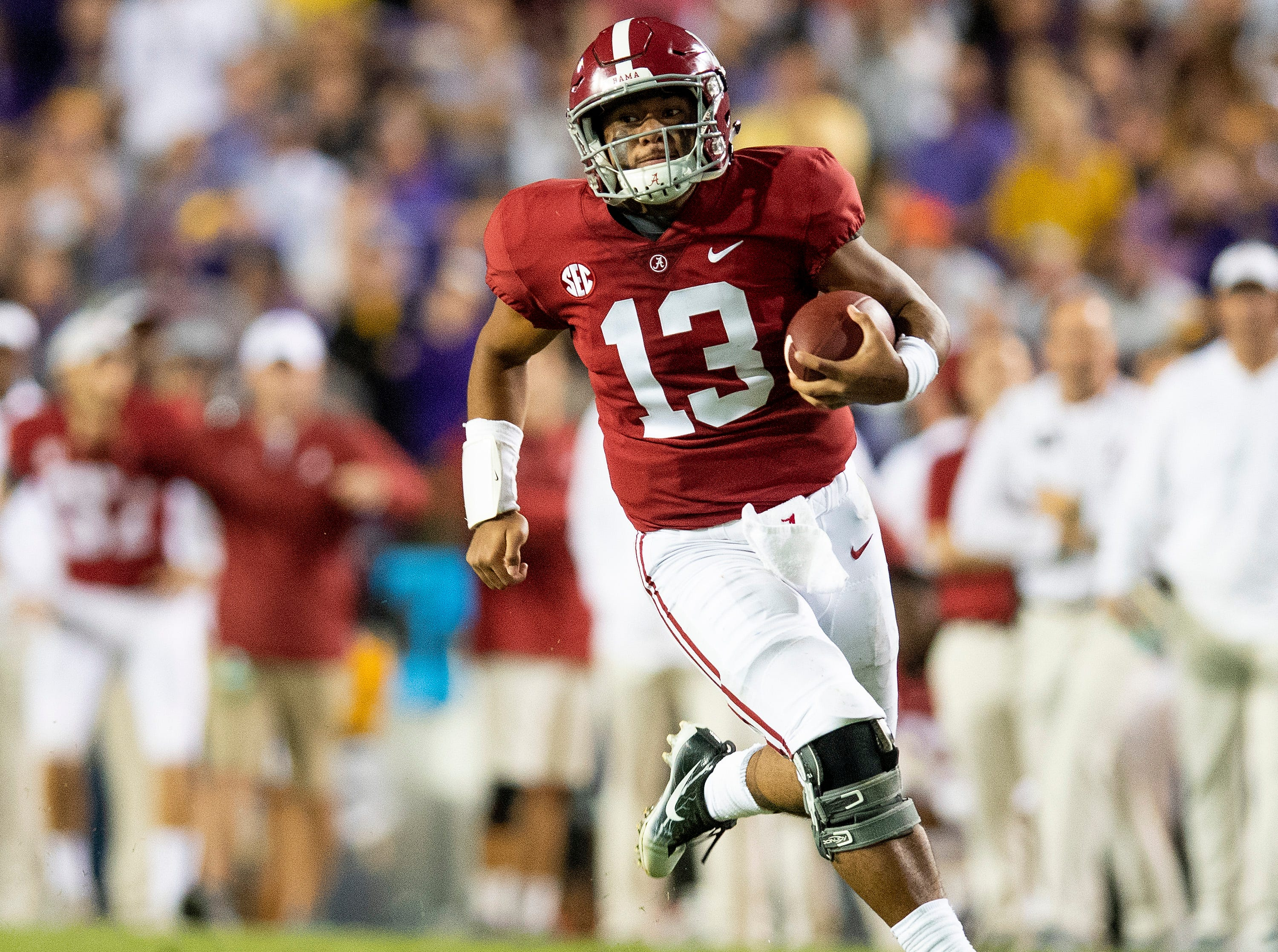 Alabama quarterback Tua Tagovailoa (13) carries for a long touchdown against LSU in second half action at Tiger Stadium in Baton Rouge, La., on Saturday November 3, 2018.