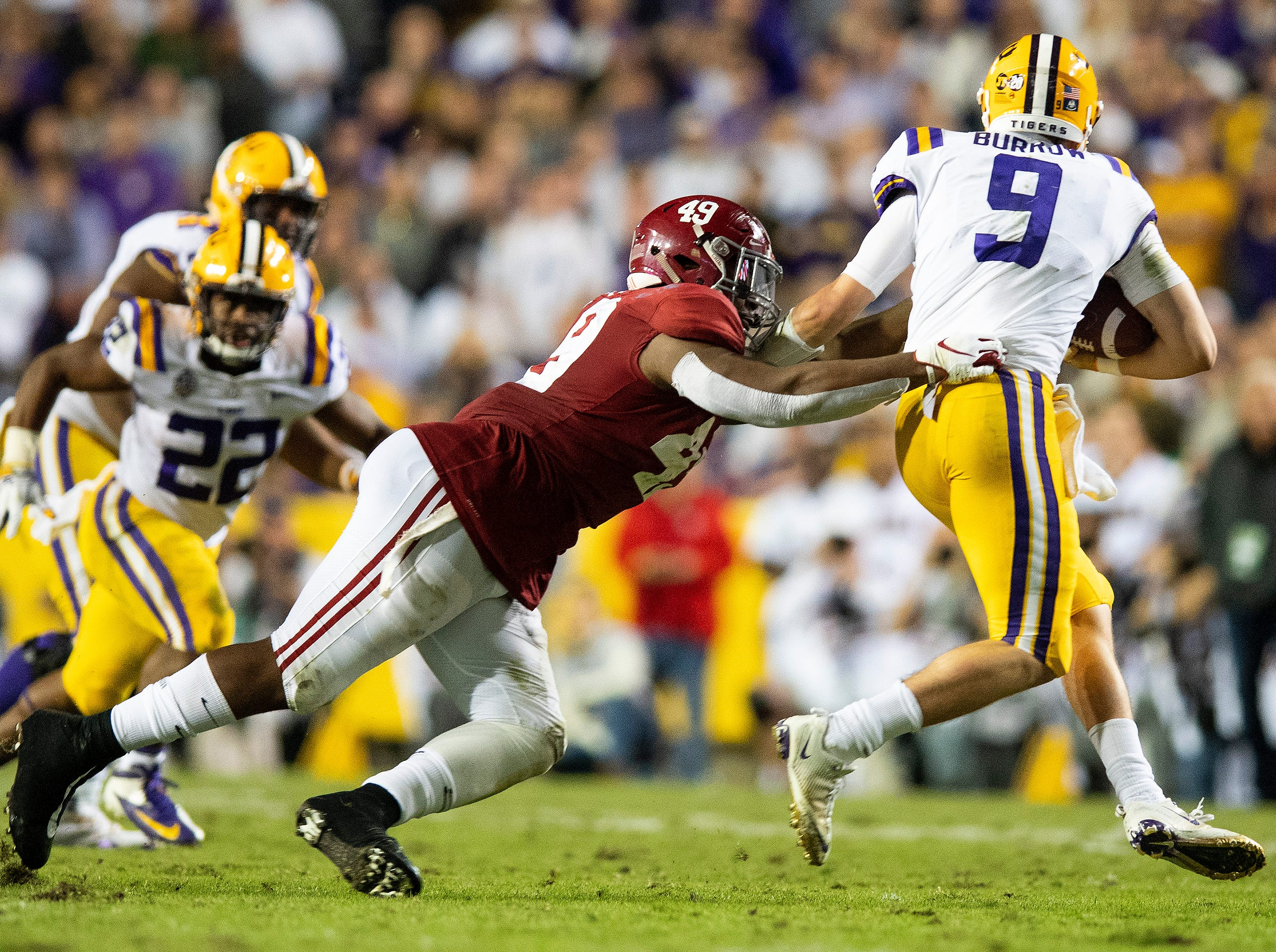 Alabama defensive lineman Isaiah Buggs (49) sacks Louisiana State University quarterback Joe Burrow (9) in second half action at Tiger Stadium in Baton Rouge, La., on Saturday November 3, 2018.