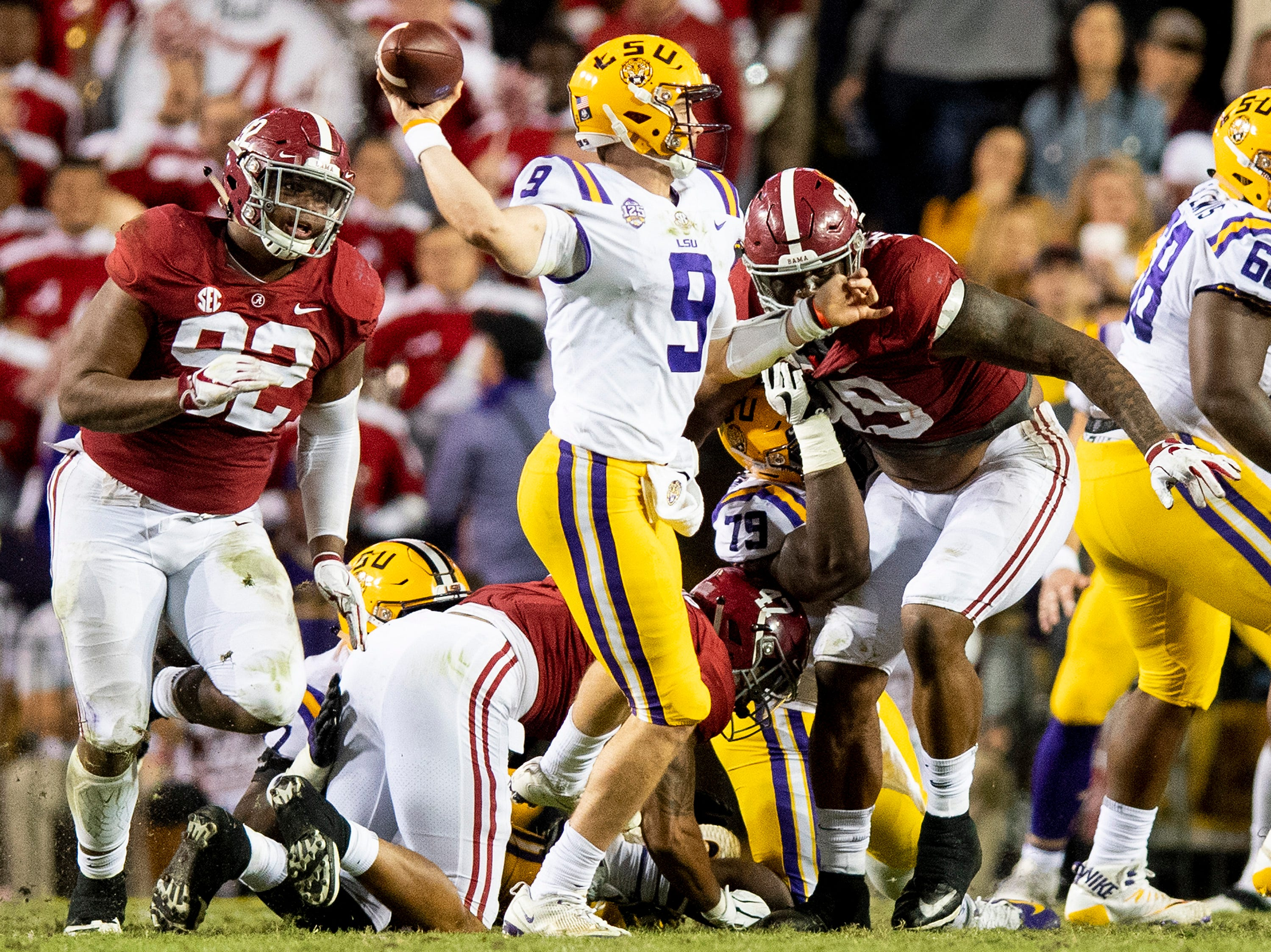 Alabama defensive linemen Quinnen Williams (92) and  Raekwon Davis (99) pressure Louisiana State University quarterback Joe Burrow (9) in second half action at Tiger Stadium in Baton Rouge, La., on Saturday November 3, 2018.