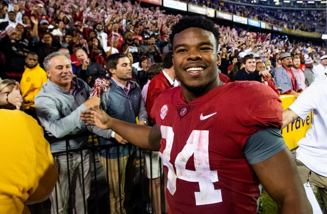 Alabama running back Damien Harris (34) greets fans after defeating LSU at Tiger Stadium in Baton Rouge, La., on Saturday November 3, 2018.