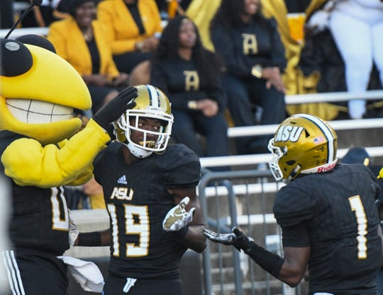 Alabama State wide receiver Michael Jefferson (19) celebrates a touchdown against Texas Southern Saturday, Nov. 3, 2018, at Alabama State University in Montgomery, Ala.