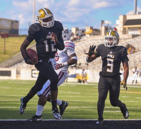 Alabama State quarterback KHA'Darris Davis (12) scores a touchdown against Texas Southern Saturday, Nov. 3, 2018, at Alabama State University in Montgomery, Ala.