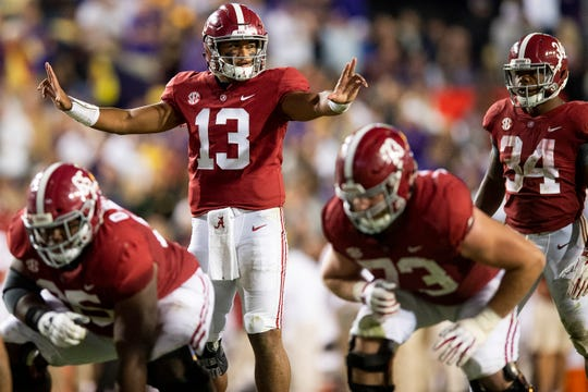Alabama quarterback Tua Tagovailoa (13) runs the offense against LSU in second half action at Tiger Stadium in Baton Rouge, La., on Saturday November 3, 2018.